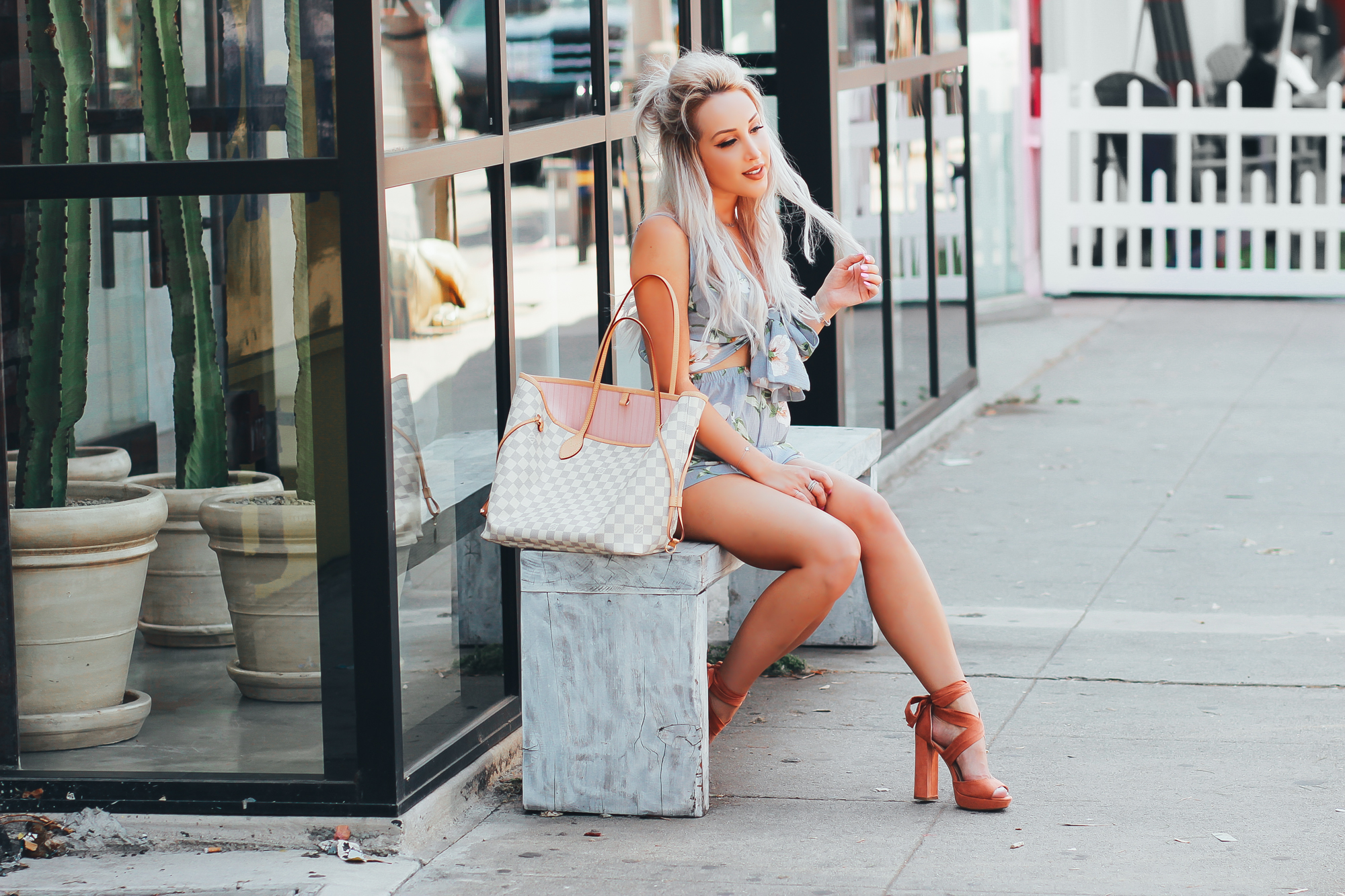 Blondie in the City | Pastel and Floral Cut-Out Bow Romper